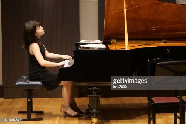 pianist palying music at small room - soloist stock photos and pictures