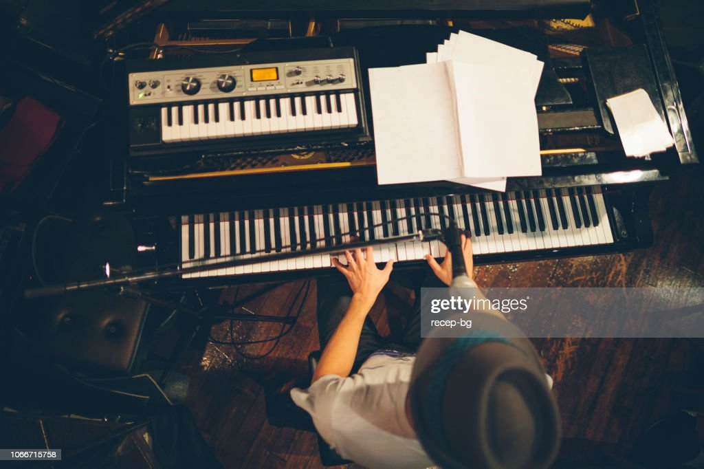 Pianist performing at stage : Stock Photo
