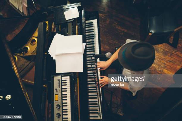 pianist performing at stage - jazz stock pictures, royalty-free photos & images