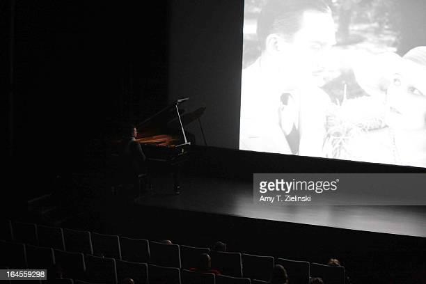 Pianist performs with a Steinway grand piano during a silent movie on stage in Cine Lumiere during 'It's All About Piano!' festival inside the The...