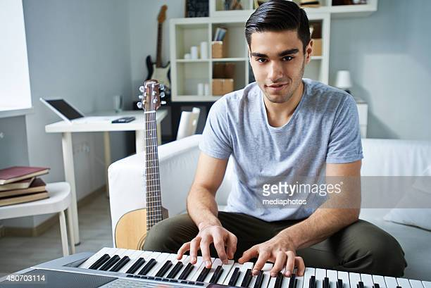 pianist - keyboard player stock photos and pictures