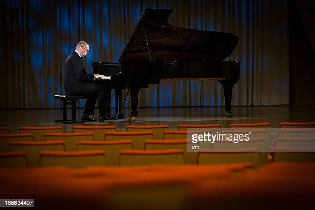 pianist playing the grand piano - pianist stock pictures, royalty-free photos & images