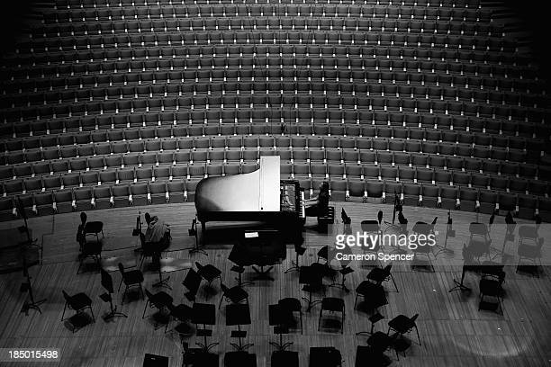 A pianist rehearses on a grand piano in the concert hall at the Sydney Opera House on September 20 2013 in Sydney Australia On October 20 2013 the...