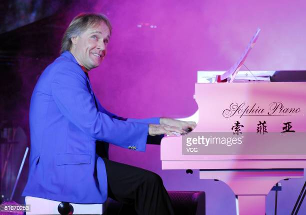 Pianist Richard Clayderman performs live on stage during his concert on June 21, 2008 in Nanning, China.