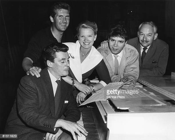 Pianist Russ Conway sits at the piano during rehearsals for the show 'Stars In Your Eyes' at the London Palladium 27th May 1960 With him are Edmund...