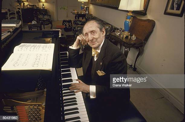 Pianist Vladimir Horowitz poised at piano at his home in NYC