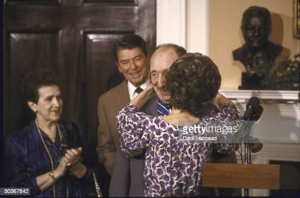 Pianist Vladimir Horowitz with President and Mrs Ronald W Reagan and wife Wanda at White House ceremony proudly wearing Medal of Freedom and getting...