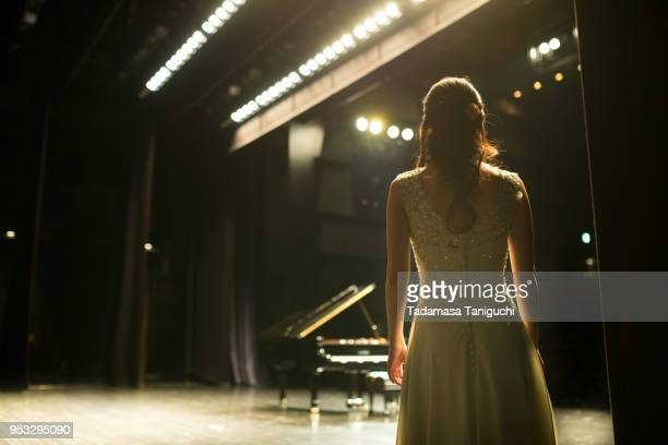 pianist walking toward to the stage - performing arts event stock pictures, royalty-free photos & images