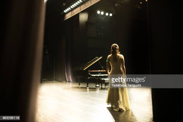 pianist walking toward to the stage - concert hall stock pictures, royalty-free photos & images