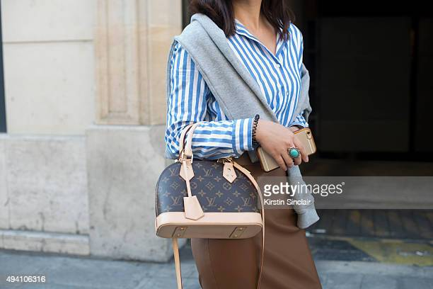 Pianist Wen Yao wears a Carven sweater Zara top Louis Vuitton bag and Zara skirt on day 3 during Paris Fashion Week Spring/Summer 2016/17 on October...
