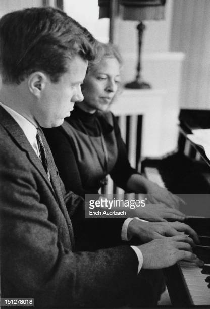 Pianist Yaltah Menuhin playing the piano with her husband Joel Ryce at Emmy Tillett's house at 11 Elm Tree Road London 18th October 1962