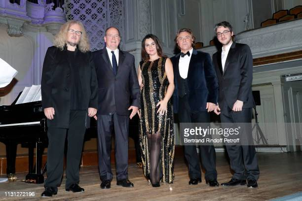 Pianist Yvan Cassar Prince Albert II De Monaco soprano Aleksandra Kurzak tenor Roberto Alagna and pianist Alexander Gadjiev acknowledge the applause...
