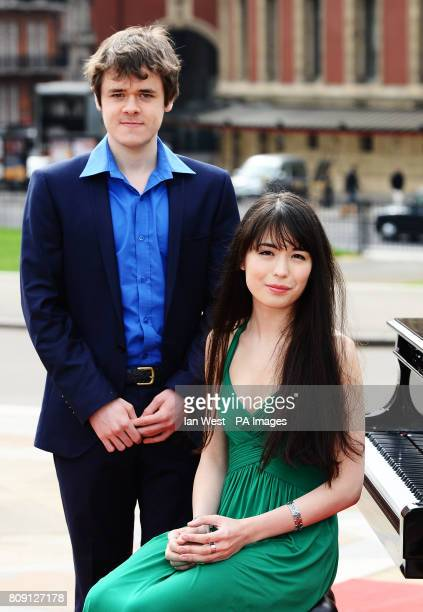 Pianists Benjamin Grosvenor and Alice Sara Ott outside the Royal Albert Hall to launch the BBC Proms 2011 on the Albert Memorial in London