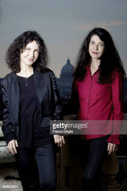 Pianists sisters Katia and Marielle Labeque pose on the central balcony of the French Academy of Villa Medici looking the St Peter's cupole on April...