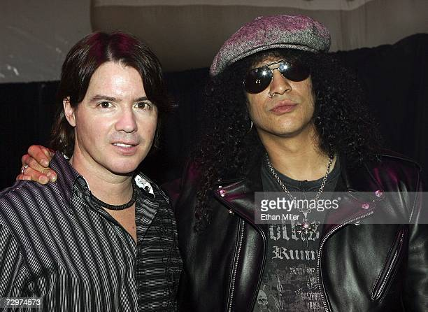 Pianist/songwriter Arthur Hanlon and Velvet Revolver guitarist Slash pose at the Gibson booth at the Las Vegas Convention Center during the 2007...