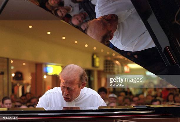 Piannist David Helfgott entertains a crowd at Milford Plaza after performing a concert in Auckland last night Helfgott afterwards signed copies of...