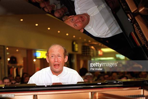 Piannist David Helfgott sings along as he entertains a crowd at Milford Plaza after performing a concert in Auckland last night Helfgott afterwards...