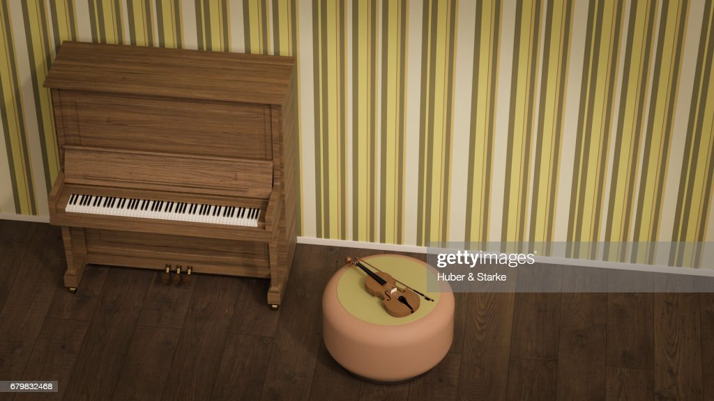 piano and violin in front of old fashioned wallpaper : Stock Photo