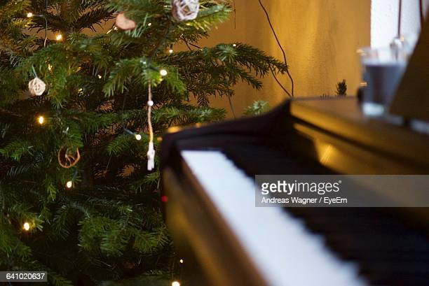 Piano By Christmas Tree At Home