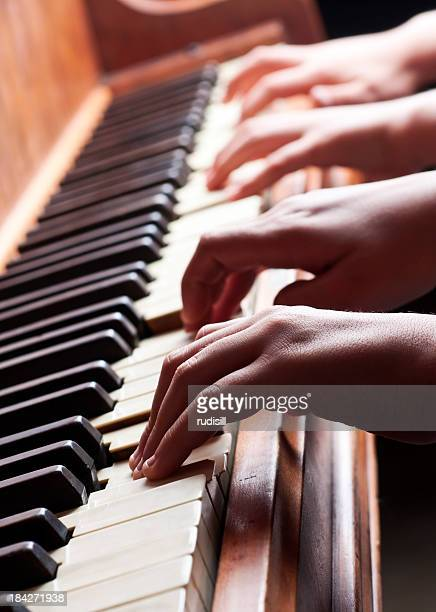 piano hands - duet stock pictures, royalty-free photos & images