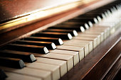 Piano keyboard of an old music instrument, close up