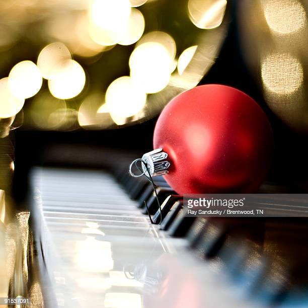 Piano Keyboard With Red Christmas Tree Ornament