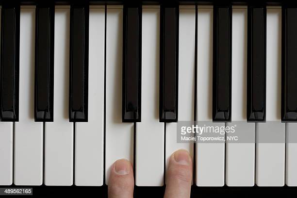 Piano keyboard with two fingers playing