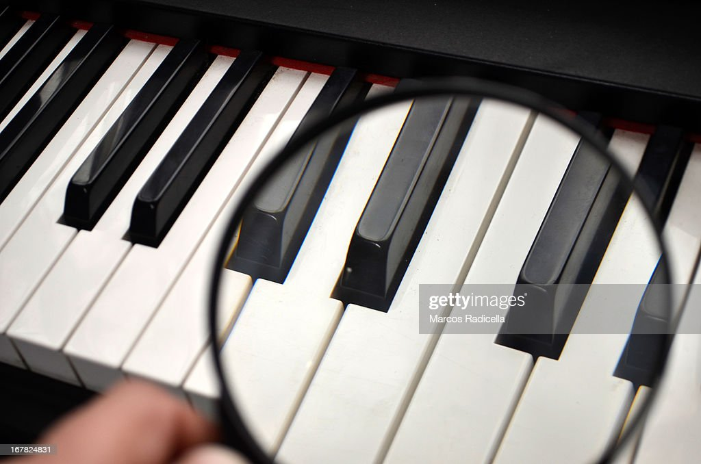 Piano keys under magnifying glass : Stock Photo