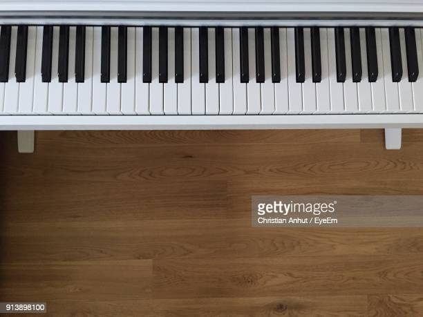 piano on hardwood floor - keyboard instrument stock photos and pictures