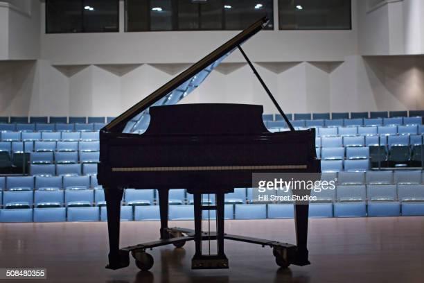 piano on stage in empty auditorium - グランドピアノ ストックフォトと画像