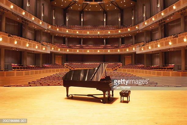 piano on stage in empty theater - grand piano stock photos and pictures