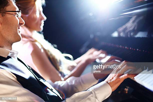 piano players in a concert. - duet stock pictures, royalty-free photos & images