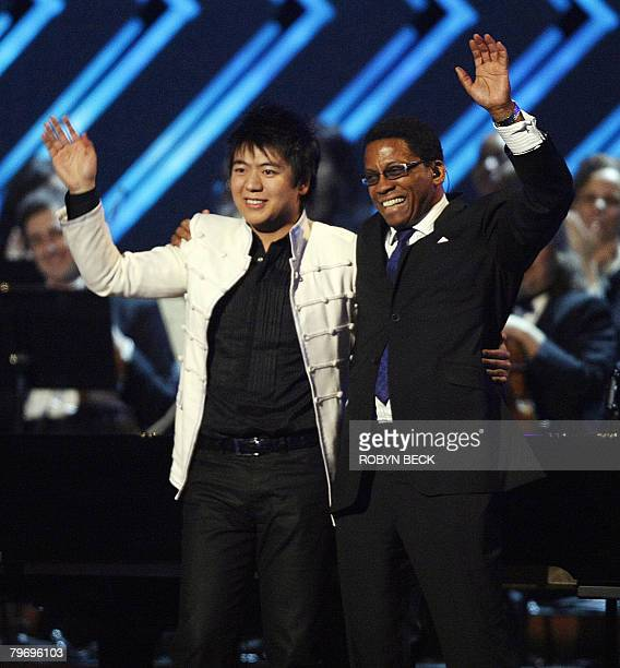 Piano players Lang Lang and Herbie Hancock salute the crowd after their performance at the 50th Grammy Awards in Los Angeles on February 10 2008 AFP...