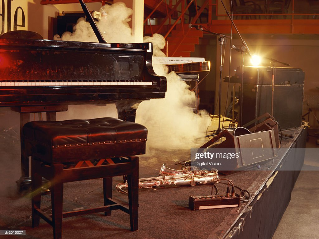 Piano, Saxophone and Microphone Stands on a Smoky Stage : Stock Photo
