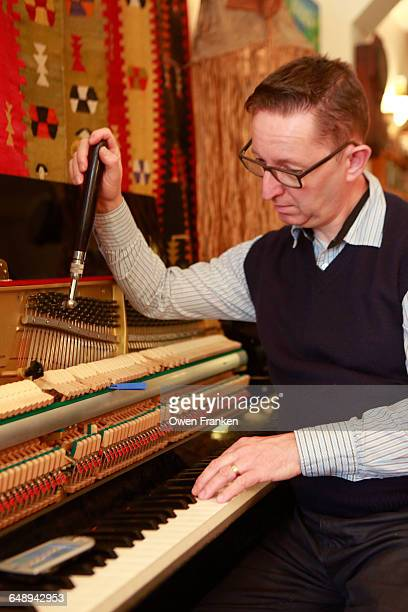 piano tuner at work