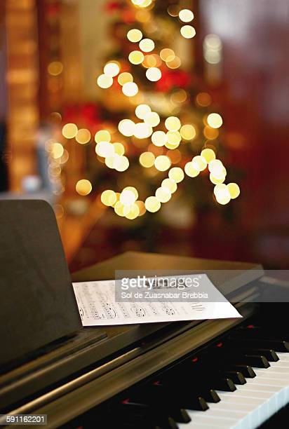 Piano with Christmas lights behind