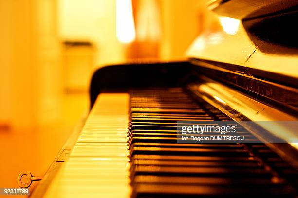 Piano with gold light