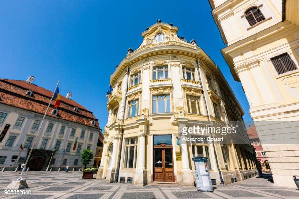 piata mare (big square) with town hall building in sibiu, transylvania, romania - sibiu stock photos and pictures