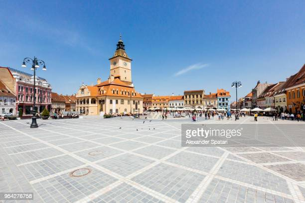 piata sfatului - main square of brasov, transylvania, romania - pedestrian zone stock pictures, royalty-free photos & images