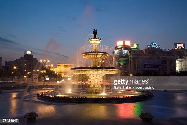 Piata Unirii fountain with the Palace of Parliament building behind, Piata Unirii, Bucharest, Romania, Europe