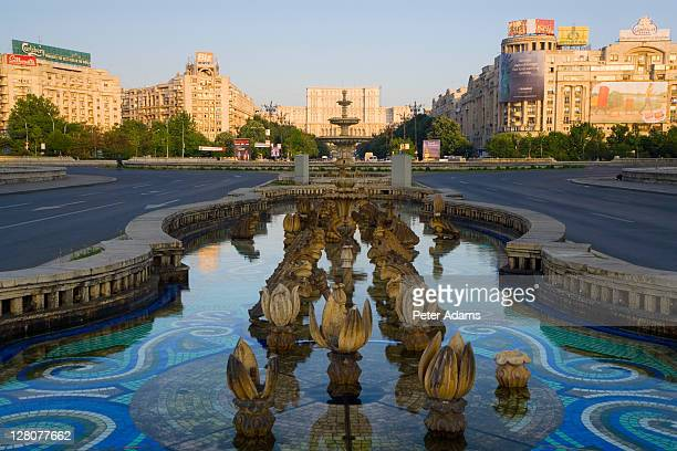 Piata Unirii Square and fountain with Palace of Parliament in the background, Bucharest, Romania
