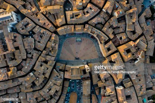piazza del campo, siena - birds eye view - siena italy stock photos and pictures