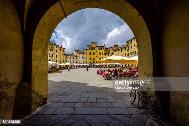 Piazza dell'Anfiteatro seen through a gate