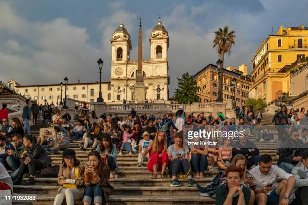 piazza di spagne, spanish steps, popular square of rome image taken  late in the afternoon - italy stock pictures, royalty-free photos & images