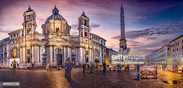 Piazza Navona after sunset and Fontana dei Fiumi by Bernini and Egypts obelisk and Santa Agnese in Agone church