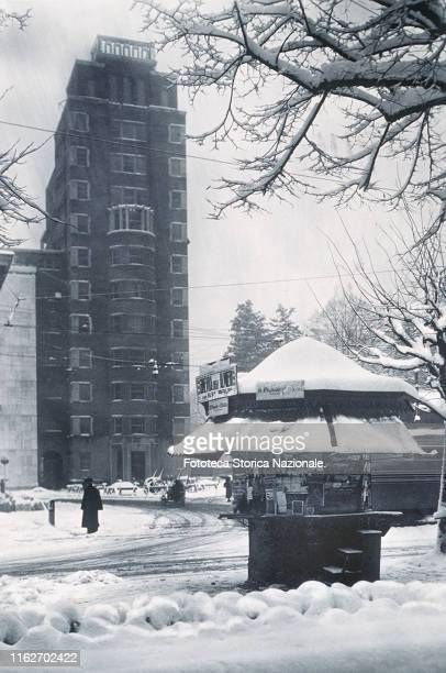 Piazza Oberdan in the snow, in the foreground a kiosk. Postcard, photograph, Italy, Milan 1939.
