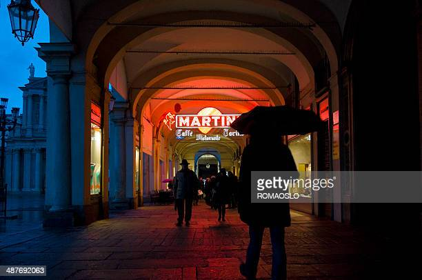 piazza san carlo arcade with neon signs, turin italy - piazza san carlo stock pictures, royalty-free photos & images