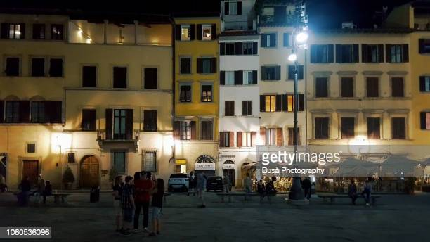 piazza santa croce at night. florence, italy - lingering stock pictures, royalty-free photos & images