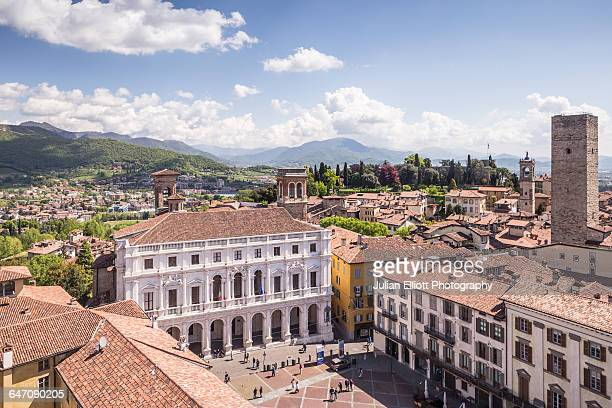piazza vecchia in bergamo alta, italy. - bergamo stock pictures, royalty-free photos & images