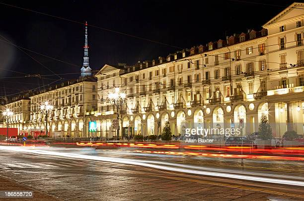 piazza vittorio veneto illuminated at night - turin stock pictures, royalty-free photos & images
